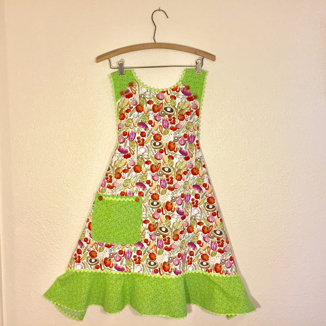 If you're dreaming of summer and getting your hands back in the dirt or wishing for bountiful trips to the local farmers market, this is the apron for you! Bright vegetable illustrations on a white background with spring green confetti ruffle and spring green rickrack.