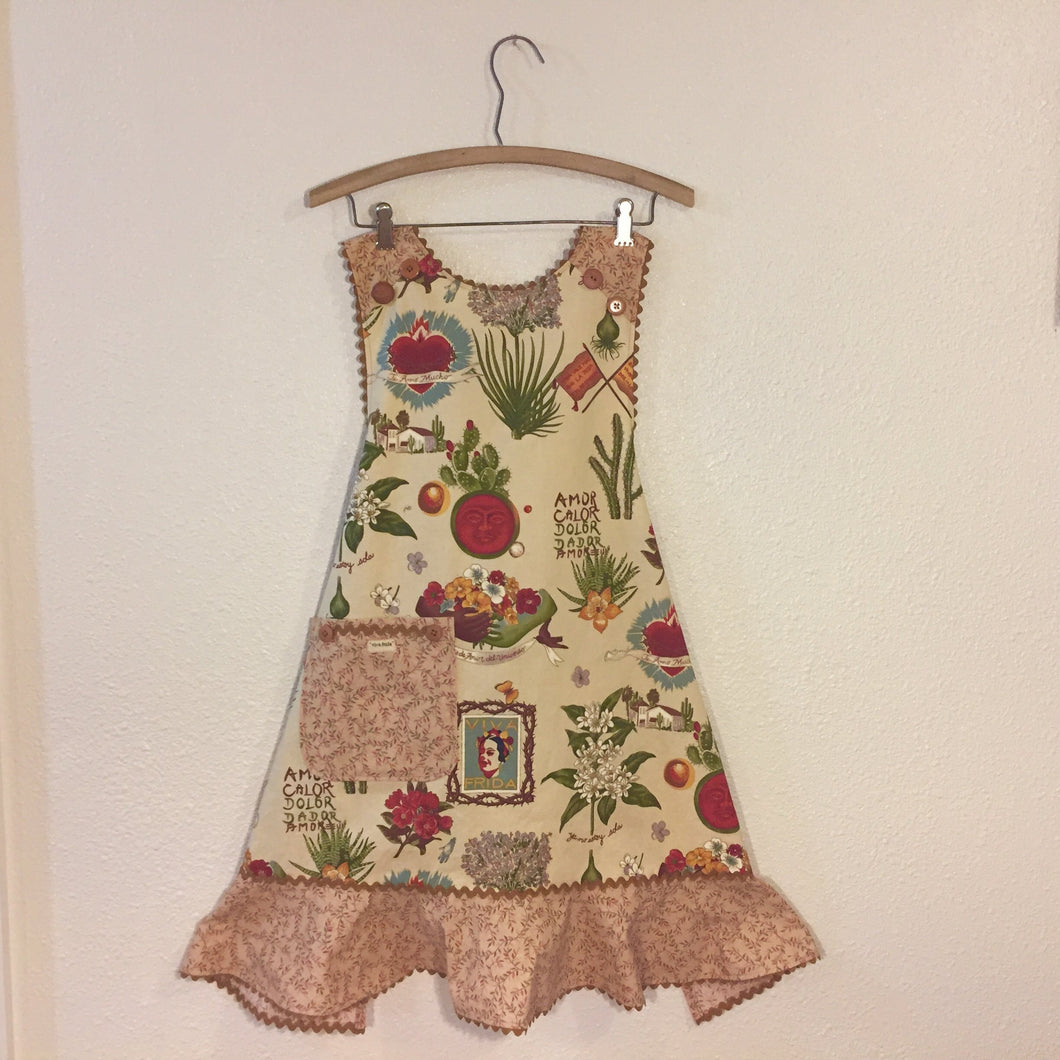 Image of apron with fabric printed with artist Frida Kahlo