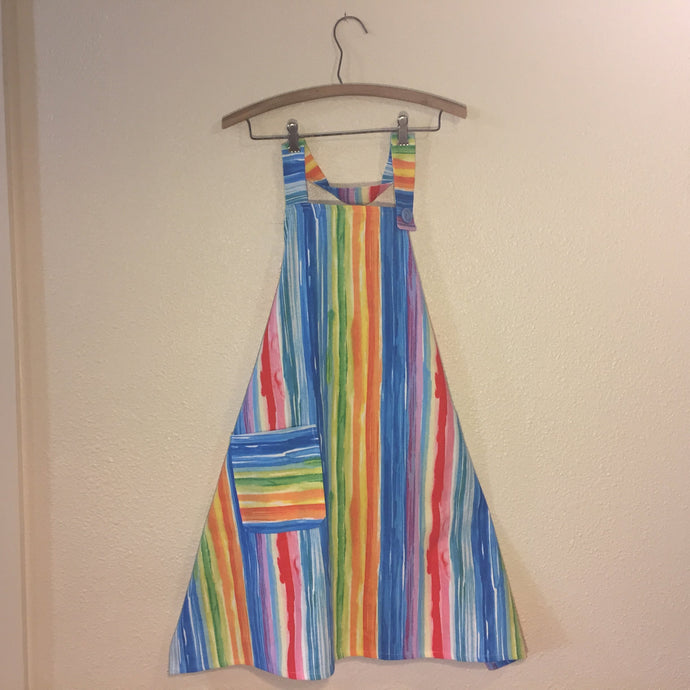Image of a fabric apron printed with multicolored watercolor stripes