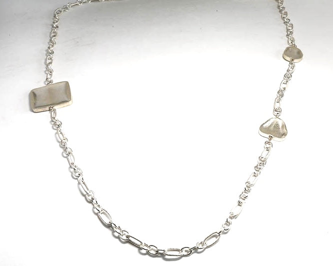 Sterling Silver Asymmetrical Chain with Sterling Silver bead accents. 38 inches long.