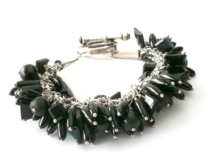Onyx and Sterling Silver Charm Bracelet with inlaid toggle clasp.