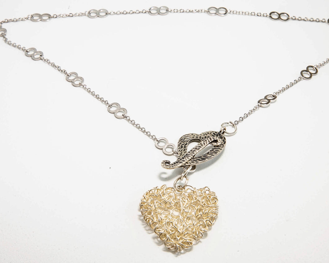 Two Sterling Silver Hearts Pendant on a Silver chain.
