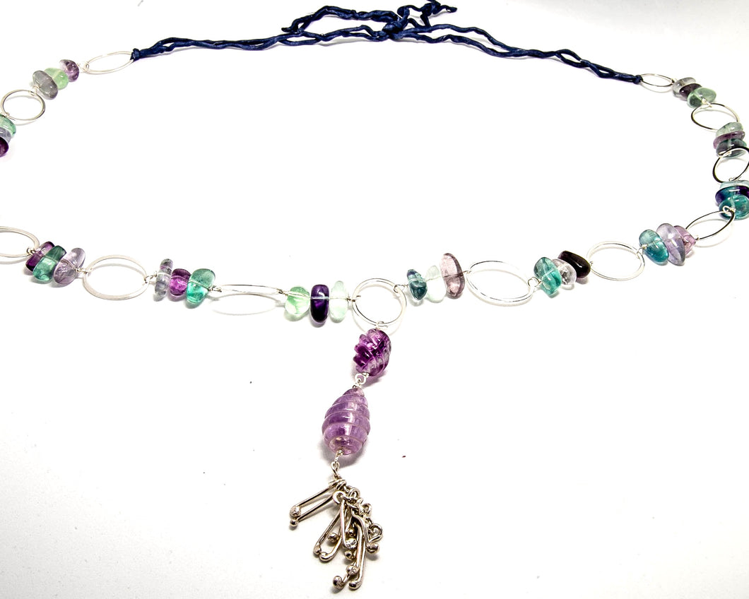 Celery and lavendar coloured Flourite Stone with tassel necklace.