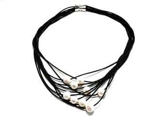Fresh water pearls on black wire multistrand necklace with magnetic clasp.