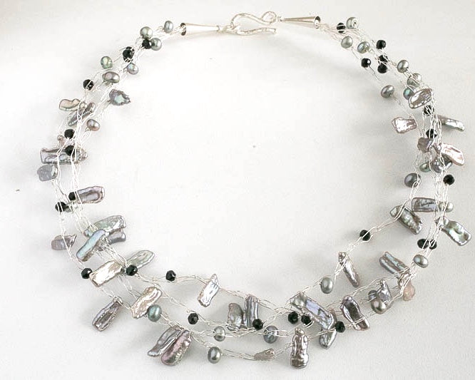 Fresh water pearl multistrand necklace available with a grey, brown, green white or peach base.