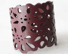 Load image into Gallery viewer, Two inch wide leather cuff laser cut with a flower design.