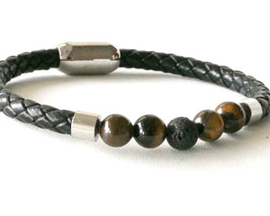 Black leather and tiger eye bracelet with stainless steel clasp.