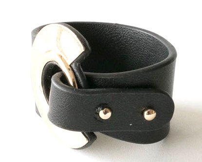 Black leather cuff that is adjustable to three sizes