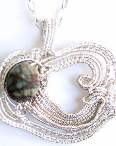 Jasper picture natural stone in a fine silver handwoven frame on a sterling silver chain.