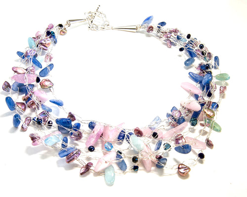 Kyanite, Aquamarine and Fresh Water Pearl multi strand necklace with a designer comfort clasp on this 18 inch necklace.