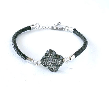 narrow braided leather bracelet with cloverleaf charm and extender chain to fit most.