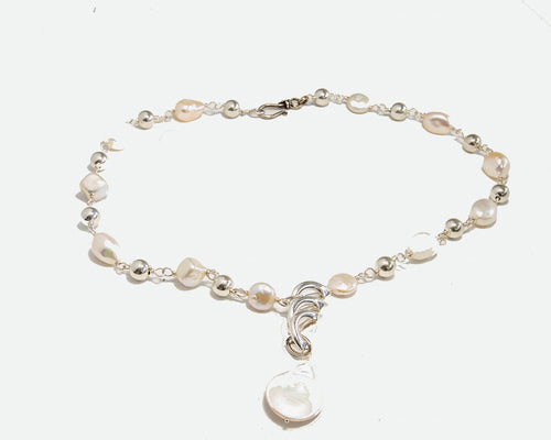 Fresh water pearl and sterling silver pendant necklace, 19 inches long with hook and eye closure.