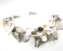 Load image into Gallery viewer, Mother of Pearl leaf shape beads handknotted with fine silver wire and a beautiful designer finish and sterling silver heart clasp.