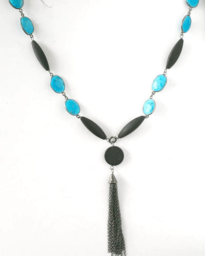 Natural Turquoise and onyx necklace accented with oxidized sterling silver. Black tassel hanging.