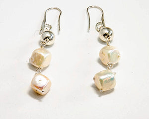 Two fresh water pearl cubes hanging from a sterling silver ball and earring hook.