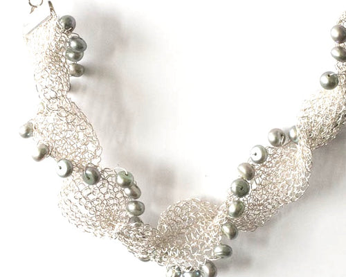 Fresh water pearls and fine silver woven necklace on an adjustable chain. From pretaporterjewels.com Jewellery that invites compliments!