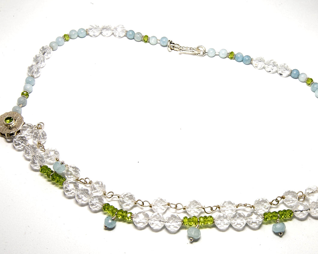 Clear Quartz, Peridot and Aquamarine two strand necklace with sterling silver hook closure.