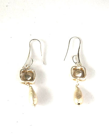 Earrings with a Sterling Silver square with tear drop bead hanging all in sterling Silver.