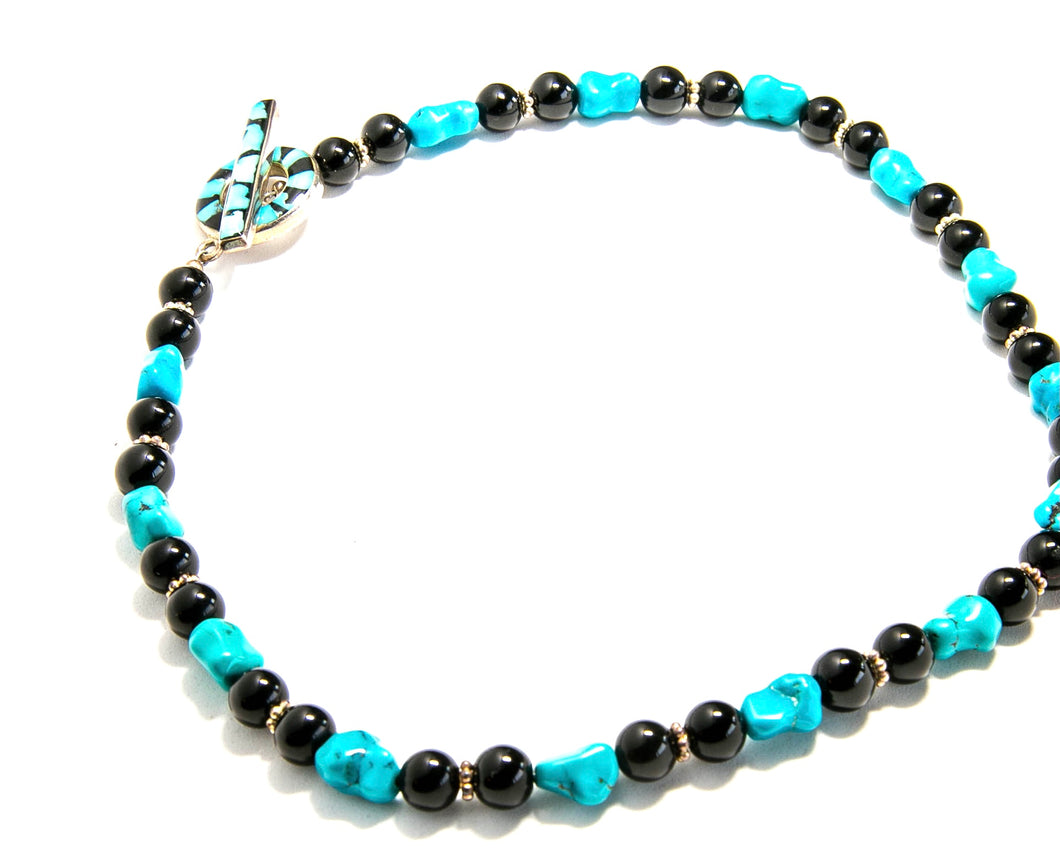 Turquoise and Onyx necklace with inlaid clasp.