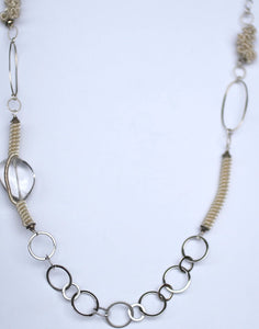 Fine silver hand made beads, with a crystal quartz with round and oval loops.