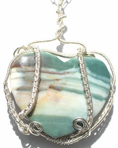 Natural jasper heart shaped pendant with fine silver woven frame on a sterling silver chain.