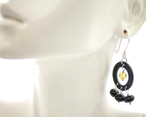 Black onyx circles with yellow Swarovski crystal in the beginning.