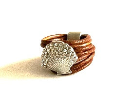 Multi strand tan leather ring with shell enhancement.