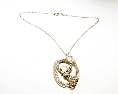 Fine silver woven pendant with two brushed silver hearts incorporated within the frame.