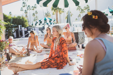 Women enjoy connecting and celebrating in a tarot circle in California.