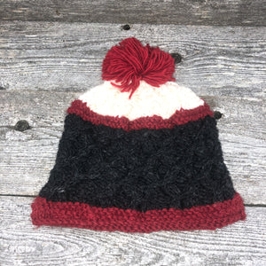 Red & charcoal grey knit hat with red Pom Pom