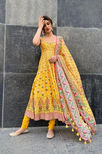 FLOWER DESIGN PRINTED YELLOW COLOUR ROUNDER KURTI WITH PLAZZO AND PRINTED PENDENT DUPATTA