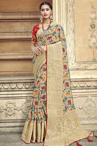 Beige red woven Patola saree with banarasi border and designer embroidered blouse