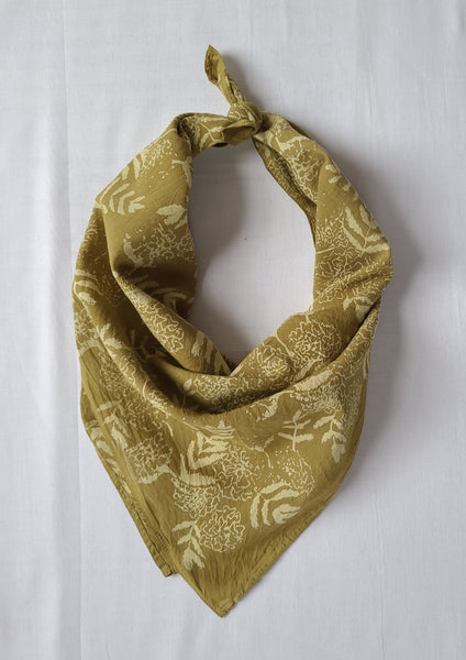 naturally dyed bandana, floral print in ochre, tied