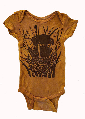 naturally dyed baby onesie, nest print golden brown