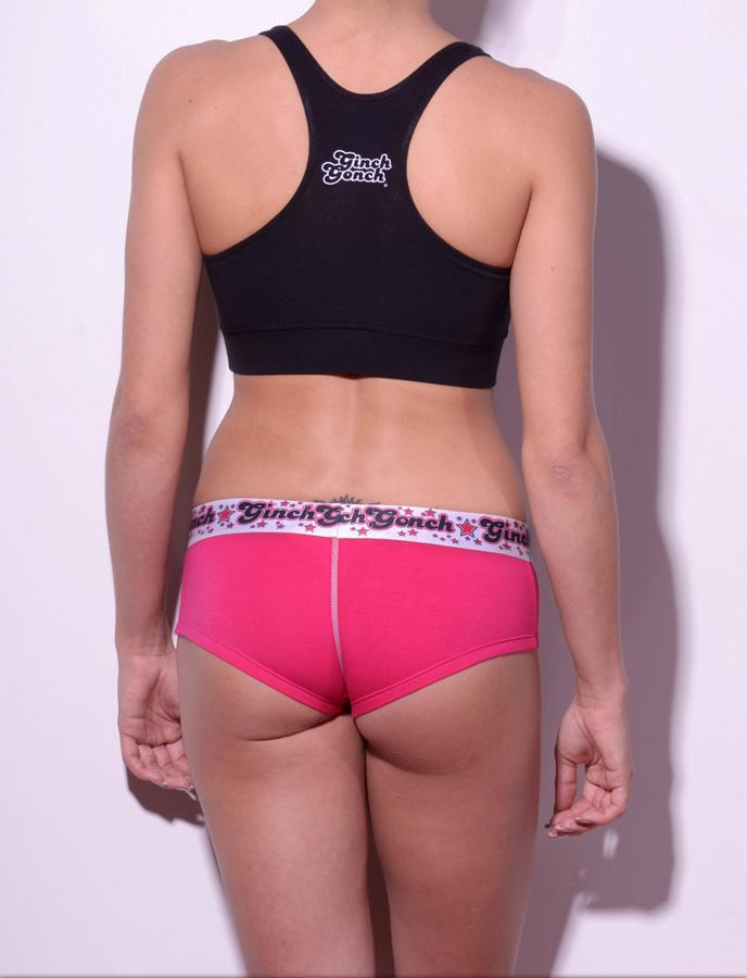GG Ginch Gonch Mean Pink women's boy cut brief underwear cheeky gogo with pink fabric with black, white, and pink printed waistband back shown with black sports bra