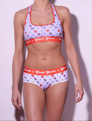 GG Ginch Gonch Hardball boy cut Brief cheeky gogo - women's Underwear - pin striped white fabric with basketballs, footballs, soccer balls, tennis balls, and baseballs. Orange trim with orange printed waistband front shown with matching sports bra