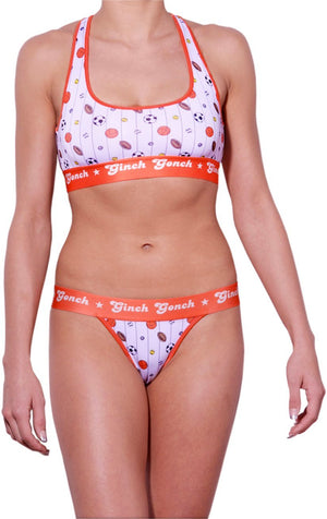 GG Ginch Gonch Hardball thong - women's Underwear - pin striped white fabric with basketballs, footballs, soccer balls, tennis balls, and baseballs. Orange trim with orange printed waistband front shown with matching sports bra