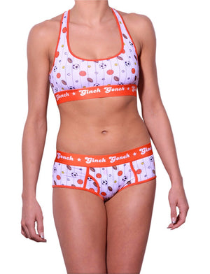 GG Ginch Gonch Hardball sports bra - women's Underwear - pin striped white fabric with basketballs, footballs, soccer balls, tennis balls, and baseballs. Orange trim with orange printed band front shown with matching briefs