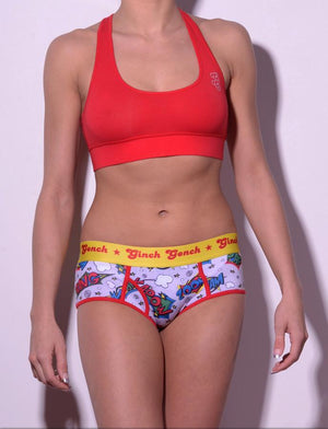 GG Ginch Gonch Under-Man Y front boy cut Brief - women's Underwear comic-inspired print on gray background with cartoon words. Red trim and yellow printed waistband front shown with red sports bra