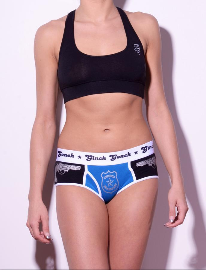 Ginch Gonch Women's Gogo Boy Cut Underwear Police, Book Em, black and blue panels with guns and badge. White trim and white printed waist band. Front. Matching Black Sports bra.