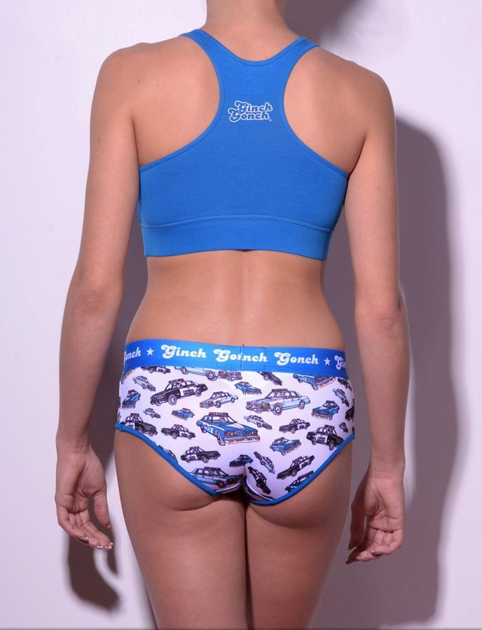 gg ginch gonch Busted boy cut brief y front - Women's Underwear with cop cars on white fabric with blue trim and printed waistband shown with blue sports bra back
