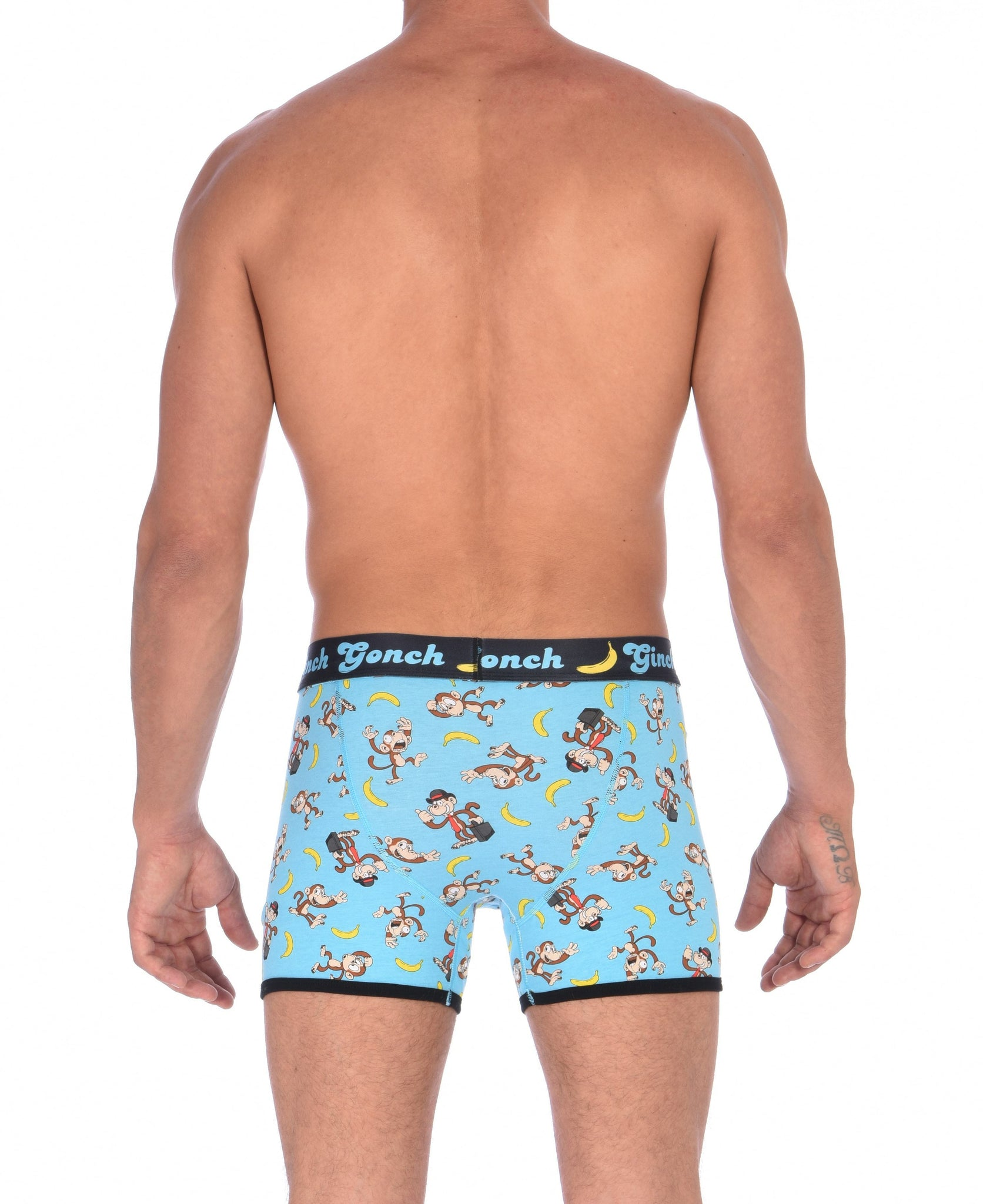Ginch Gonch Monkey Business Boxer Brief Trunk with blue background, monkeys, and bananas. Black trim and printed waistband with Ginch Gonch and bananas. Back