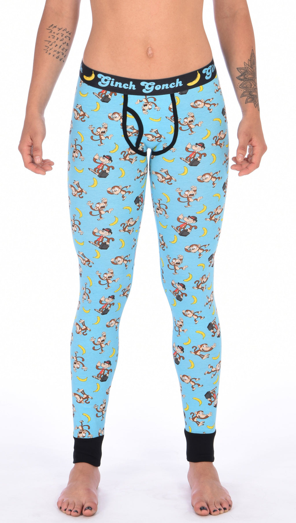 Ginch Gonch Monkey Business Women's Leggings Long Johns Underwear with blue background, monkeys, and bananas. Black trim and printed waistband with Ginch Gonch and bananas. Front.