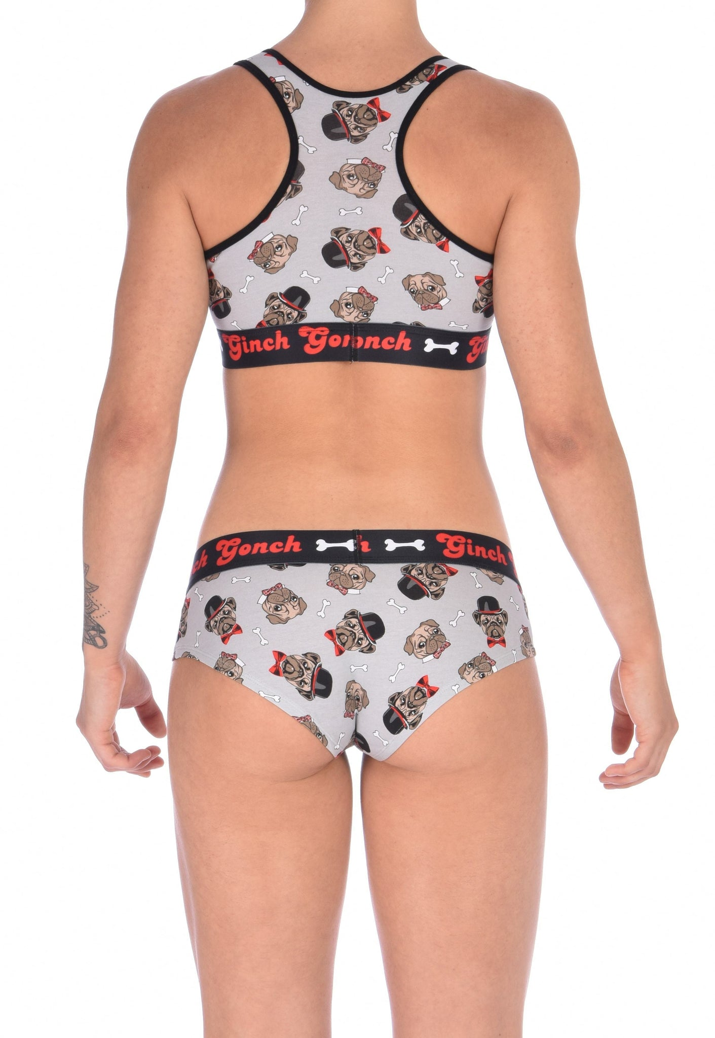 GG Ginch Gonch Pug Life boy cut brief cheeky gogo - women's Underwear grey background with pugs with top hats and bow ties and bones. Black trim with black printed waistband back. Shown with matching sports bra