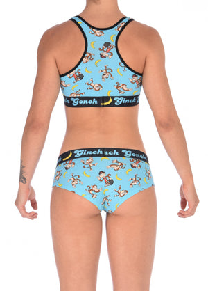 Ginch Gonch Monkey Business Women's Underwear boy cut brief, gogo, with blue background, monkeys, and bananas. Black trim and printed waistband with Ginch Gonch and bananas. Back. With matching sports bra.