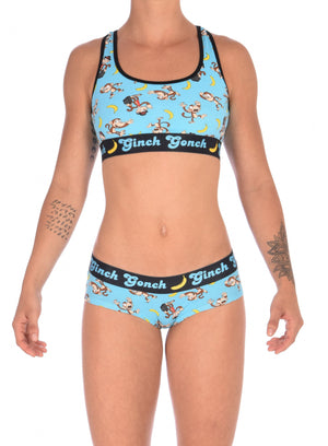Ginch Gonch Monkey Business Women's Underwear boy cut brief, gogo, with blue background, monkeys, and bananas. Black trim and printed waistband with Ginch Gonch and bananas. Front. With matching sports bra.