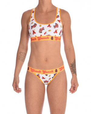 Ginch Gonch GG Fire Fighters thong women's underwear y front white fabric with fire engines hats and hydrants, yellow trim and printed yellow waistband front shown with matching sports bra