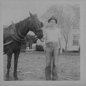 Amos Stoltzfus and his horse on the family farm