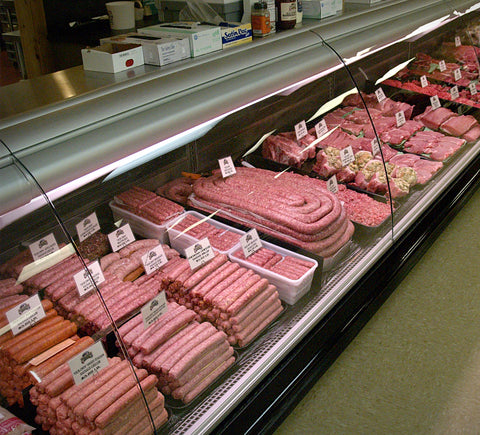 Stoltzfus Meats display case with various meat products