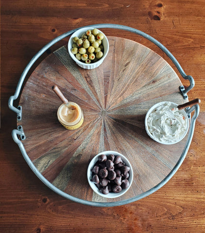 olives, spreads, and wilbur buds on a charcuterie board